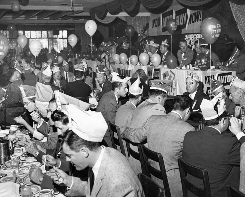 . Six hundred Valley businessmen gathered for breakfast \'kickoff\' meeting to launch \'You Auto Buy Now\' campaign on April 18, 1958. Crowd included valley automobile dealers, Chamber of Commerce executives and representatives retail merchants in the Valley.  (Los Angeles Public Library)