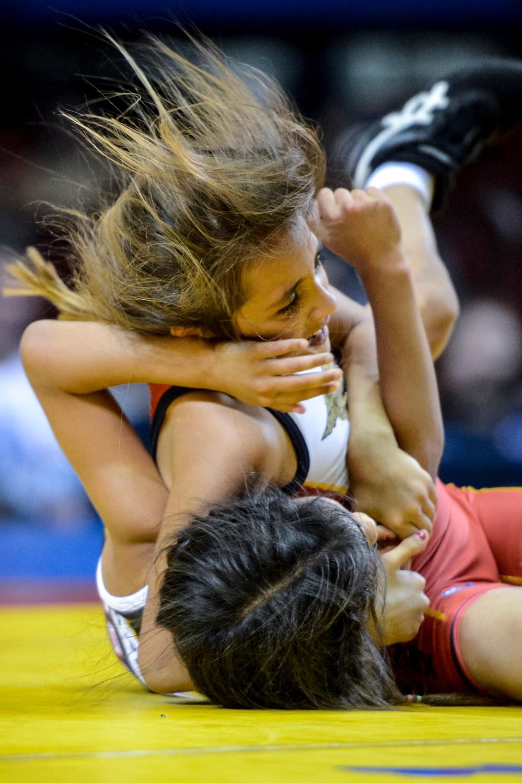 . Patricia Arana,9, of Pacoima takes down Viviana Garcia, 9, of San Fernando during their match at the USA vs Russia vs Canada dual meet at the Sports Arena Sunday .  Photo by David Crane/Los Angeles Daily News.