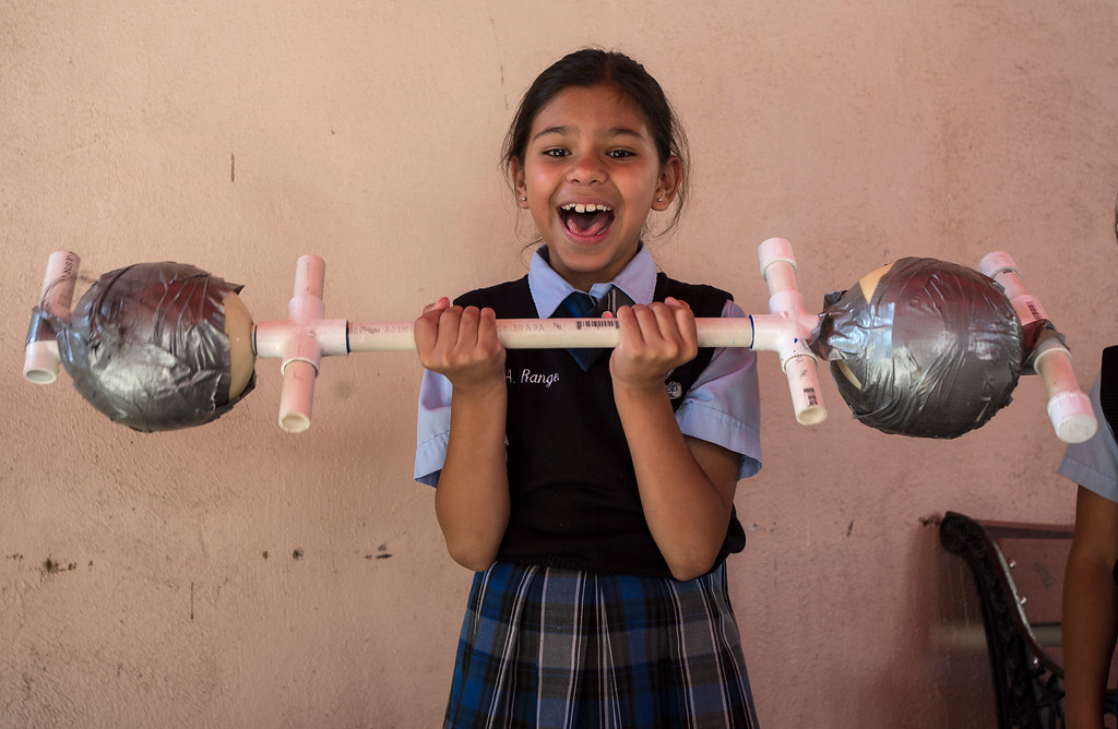 . Second-grader Audrina Rangel, 7, lifts a bar with a watermelon on each side during the Nutrition Olympics for kids in grades 1-4 at Guardian Angel School in Pacoima on Friday, June 09, 2017. According to Lauren Lewow, external communication specialist, we�re honored to work with Guardian Angel School to bring programming like this nutrition Olympics to local communities served by Providence Health & Services. In 2016, Providence Health & Services spent $25 million on community health care and education programs, including charity care and wellness programming for the San Fernando Valley, Westside and South Bay including the Providence Community Health Wellness and Activity Center in Wilmington and the tattoo removal program in the Valley. (Photo by Ed Crisostomo, Los Angeles Daily News/SCNG)