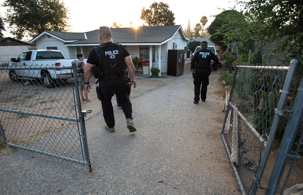 . David Marin, Field Office Director, left, and ICE Fugitive Enforcement Operations Team move towards a resident seeking a criminal alien fugitive in Riverside County on Thursday, June 22, 2017. (Photo by Ed Crisostomo, Los Angeles Daily News/SCNG)