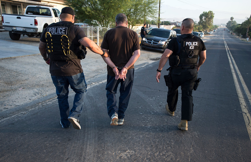. David Marin, Field Office Director, right, and ICE Fugitive Enforcement Operations Team take into custody Fidel Delgado Guerrero, an undocumented immigrant, in Riverside County on Thursday, June 22, 2017. (Photo by Ed Crisostomo, Los Angeles Daily News/SCNG)