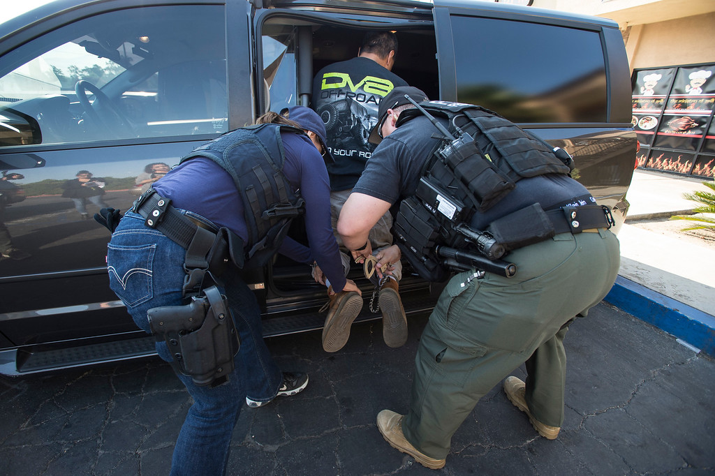 . ICE Fugitive Enforcement Operations Team take into custody a criminal alien fugitive in Riverside County on Thursday, June 22, 2017. (Photo by Ed Crisostomo, Los Angeles Daily News/SCNG)