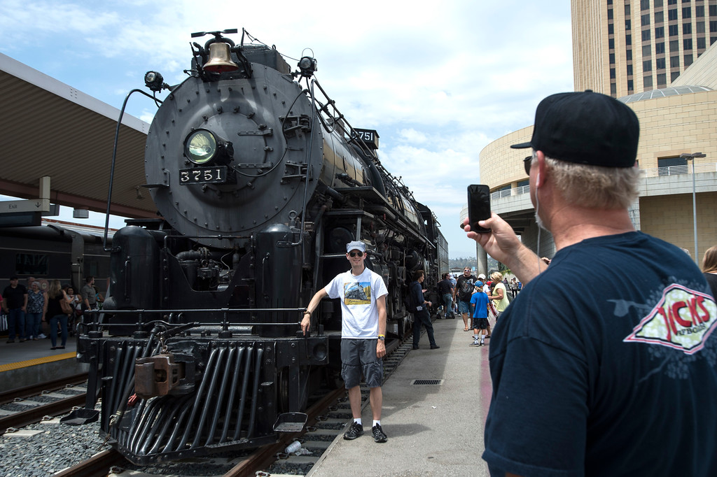 . Brian Liivoja, right, of Anaheim, takes a photograph of his son Matthew by the Santa Fe 3751, 1927 Steam Locomotive during the Union Station Summer Train Fest at the Union Station in Los Angeles on Saturday, July 15, 2017. (Photo by Ed Crisostomo, Los Angeles Daily News/SCNG)
