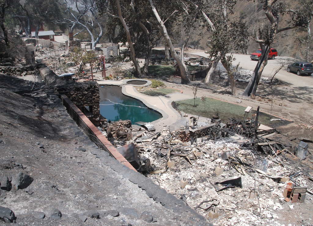 . Santa Clarita, Ca   Two of 5 houses on a road on Little Tujunga Road just a mile north of Sand Canyon are in ruins after the Sand Fire rampaged through the area last night...All thats left is the pool. (Photo by Mike Meadows)