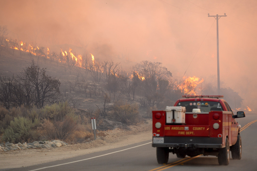 . Flames move towards Soledad Canyon road in Action Sunday.    More than 15 structures have been destroyed in the fire which has consumed more than 22,000 acres so far with 10% containment.  (Photo by David Crane Southern California News Group)