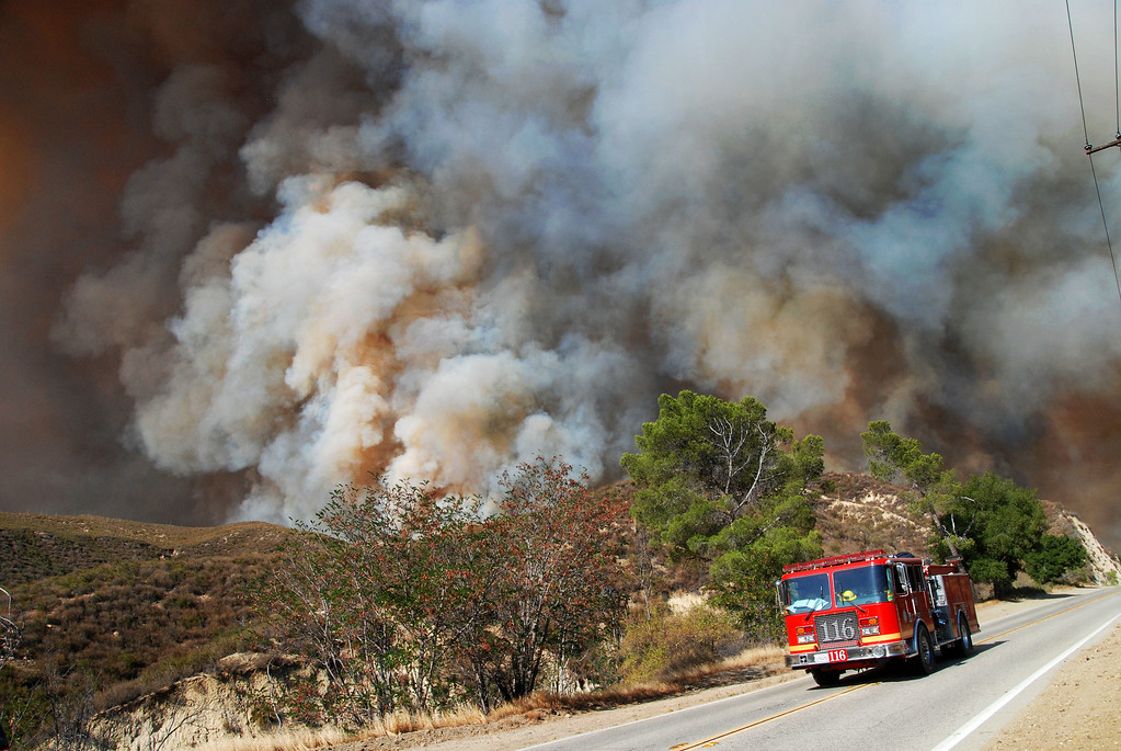 . Santa Clarita, Ca  An LA County engine makes it down Placerita Canyon as fire takes out the entire canyon. (Photo by Mike Meadows)