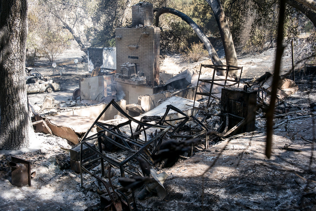 . A completely destroyed home in the 18200 block along Little Tujunga Sunday morning.  More than 15 structures have been destroyed in the fire which has consumed more than 22,000 acres so far with 10% containment.  (Photo by David Crane Southern California News Group)