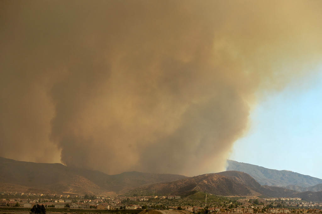 . A huge column of smoke rises from the Sand fire near Via Princessa in Santa Clarita Sunday.   More than 15 structures have been destroyed in the fire which has consumed more than 22,000 acres so far with 10% containment.  (Photo by David Crane Southern California News Group)