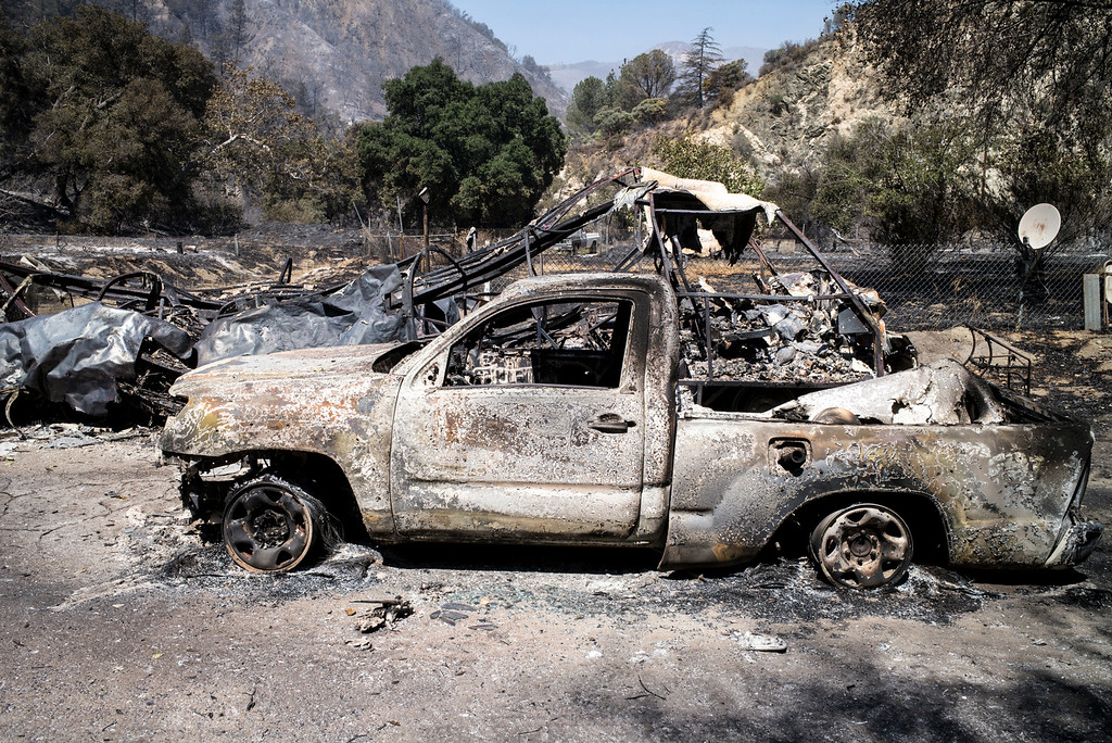 . Vehicles and property destroyed by fire in the 18200 block along Little Tujunga Sunday morning.  More than 15 structures have been destroyed in the fire which has consumed more than 22,000 acres so far with 10% containment.  (Photo by David Crane Southern California News Group)