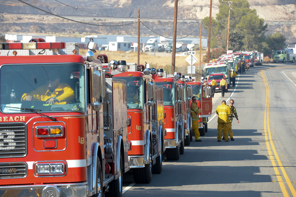 . A strike team of more than 25 fire engines staged along Soledad Canyon in Santa Clarita Sunday morning for the Sand fire.   More than 15 structures have been destroyed in the fire which has consumed more than 22,000 acres so far with 10% containment.  (Photo by David Crane Southern California News Group)