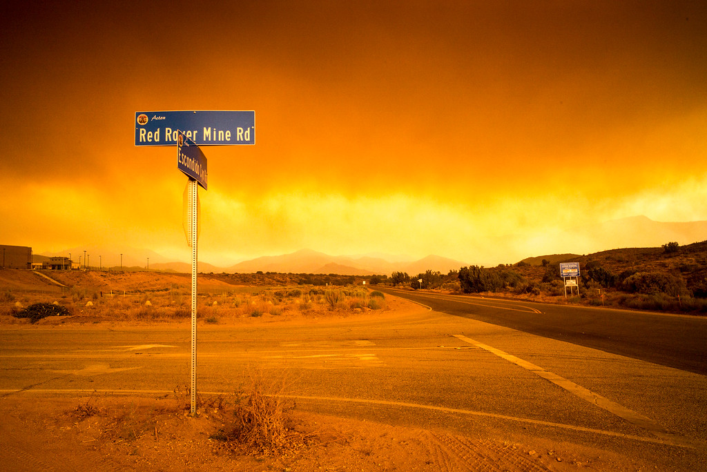 . The sky turns deep red with smoke and ash Sunday as the Sand fire burns towards Acton, CA.   More than 15 structures have been destroyed in the fire which has consumed more than 22,000 acres so far with 10% containment.  (Photo by David Crane Southern California News Group)
