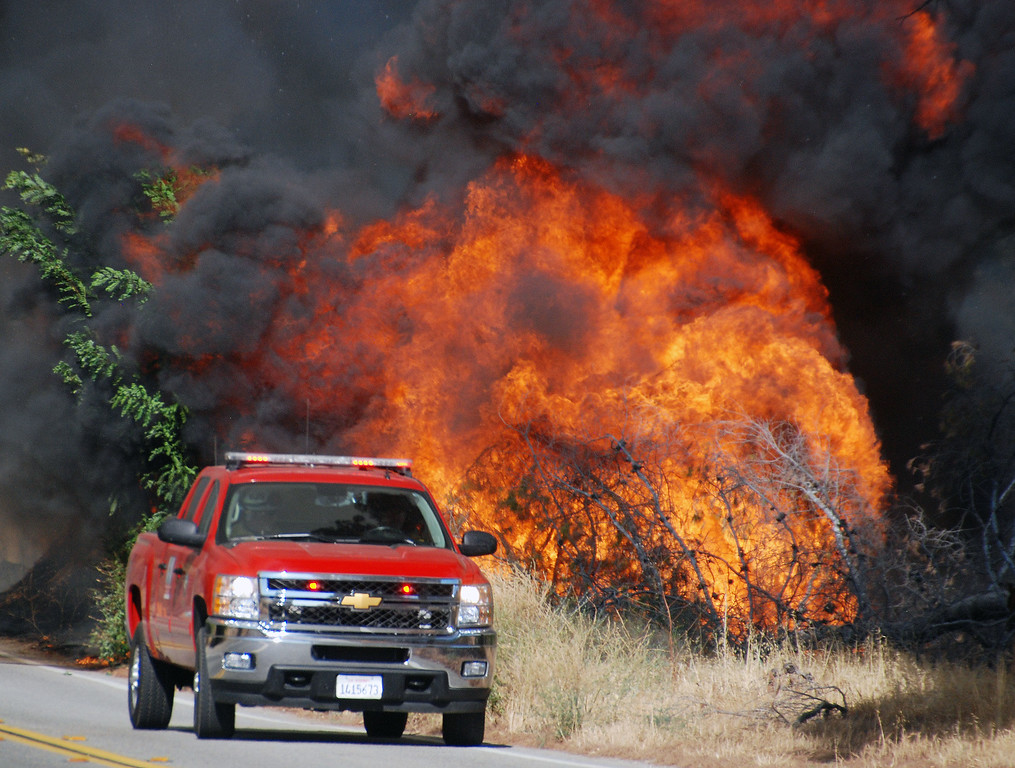 . Santa Clarita, Ca  A truck with fire personnel just makes it past heavy fire as they move down of Placerita Canton.(Photo by Mike Meadows)