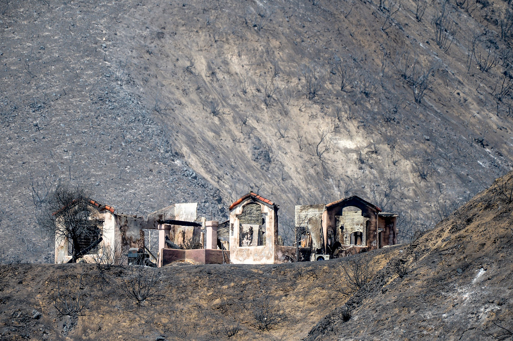 . A completely destroyed home along Little Tujunga Sunday morning.  More than 15 structures have been destroyed in the fire which has consumed more than 22,000 acres so far with 10% containment.  (Photo by David Crane Southern California News Group)