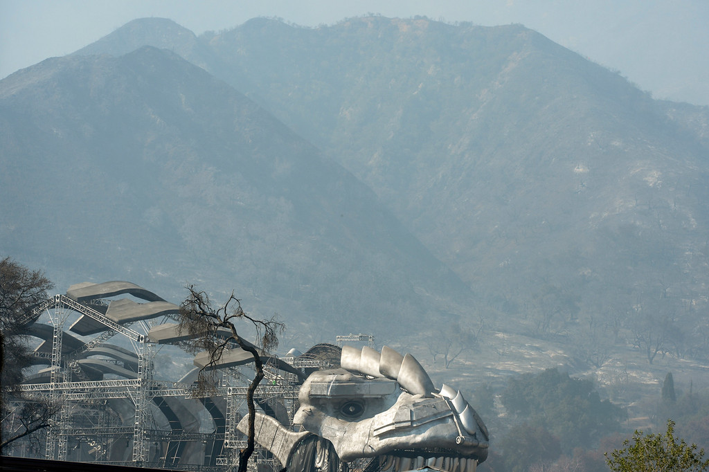 . A movie set on the Disney Ranch along Sand Canyon sets the stage for burned hillsides of the Angeles National Forest. The Sand fire has burned more than 22,000 acres so far with 10% containment.  (Photo by David Crane Southern California News Group)