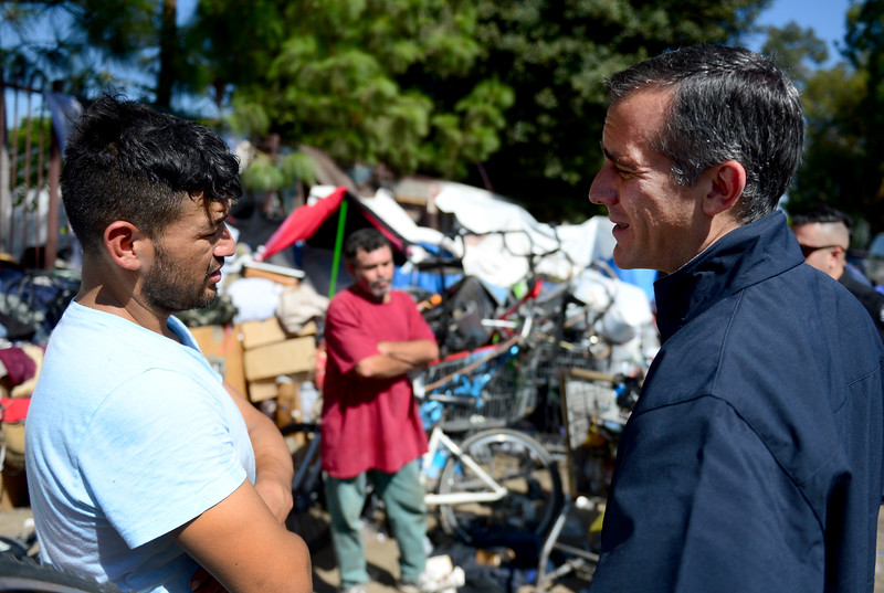 The LAPD showed Mayor Eric Garcetti and Councilwoman Nury Martinez, how a pilot program called H.O.P.E. is working out.  The mayor talks with Octovio Sanchez on Thursday, September 8, 2016.  (Photo by Dean Musgrove, Los Angeles Daily News/SCNG)