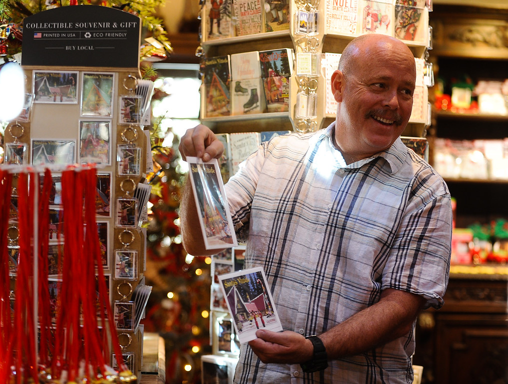 . Jeff Nehls, manager of the Sky Trading Company gift shop, shows Santa\'s Village post cards during a tour of gift shop at the new Sky Park at Santa\'s Village in the Lake Arrowhead community of Skyforest, Calif. on Wednesday, Oct. 19, 2016. The amusement park is hoping to be granted the county permit to open and operate the Santa\'s Village portion of the park by Nov. 1. (Photo by Rachel Luna/The Sun, SCNG)