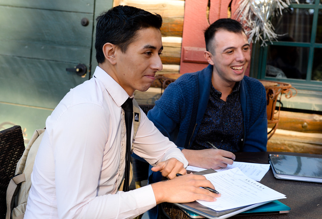 . Actors Ethan Nathan, 20, left, and Edward Little, 21, both of San Bernardino, fill out a job application to work as entertainers after auditioning at the new Sky Park at Santa\'s Village in the Lake Arrowhead community of Skyforest, Calif. on Wednesday, Oct. 19, 2016. The amusement park is hoping to be granted the county permit to open and operate the Santa\'s Village portion of the park by Nov. 1. (Photo by Rachel Luna/The Sun, SCNG)