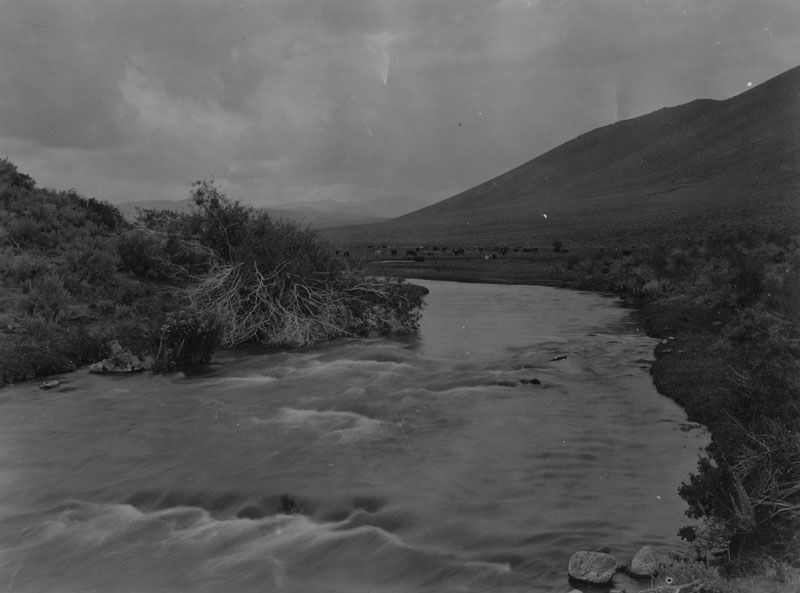 . The Owens River in Long Valley near the point it enters the gorge on June 25, 1930. The land shown here would be flooded if the proposed Long Valley Reservoir is created by the dam in Owens River Gorge. The lake would be the largest artificial body of water, except Boulder Dam Reservoir, ever proposed.  (Los Angeles Public Library)