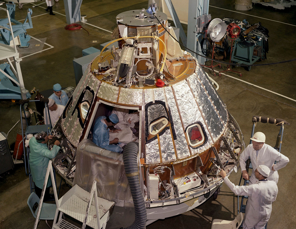 . In this 1966 photo made available by NASA, technicians work on the Spacecraft 012 Command Module at Cape Kennedy, Fla., for the Apollo/Saturn 204 mission. During a launch pad test on Jan. 27, 1967, a flash fire erupted inside the capsule killing three Apollo crew members. (NASA via AP)