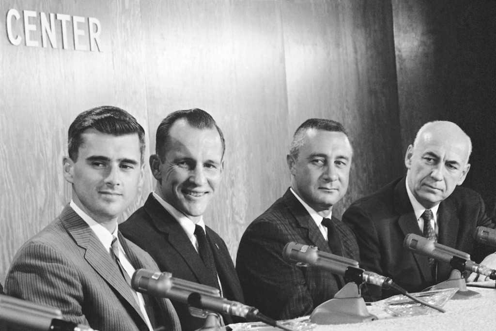 . Dr. Robert B. Gilruth, right, director of the Manned Spacecraft Center, at a news conference in Houston on March 21, 1966 where he named the astronauts on his right as the crew to board the first manned Apollo flight. The crew, from left to right are: Roger B. Chaffee, Edward H. White II and Virgil I. Grissom. White and Grissom are veterans in space; Chaffee will be making his first flight. (AP Photo/Ted Powers)
