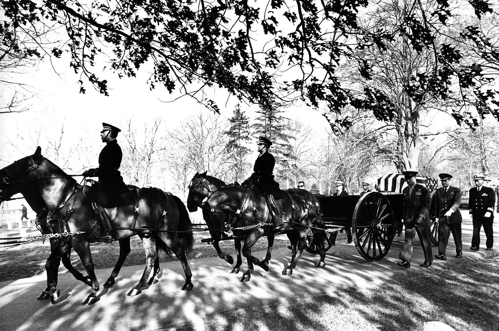 . A horse drawn caisson bearing the body of astronaut Virgil Grissom rolls through nearby Arlington National Cemetery in Arlington, Va., Jan. 31, 1967.  Walking beside the flag-draped casket as honor pallbearers are astronauts, from left on this side of caisson, Marine Col. John Glenn, Air Force Col. Gordon Cooper, Navy Cmdr. John Young; from left on far side of casket, Donald Slayton, Navy Capt. Alan Sheperd and Navy Cmdr. Scott Carpenter.  Grissom was killed in the Apollo 1 fire on launch pad on Jan. 27.  (AP Photo)