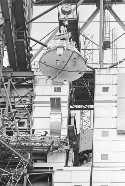 . The Apollo 1 spacecraft, with black smudge marks visible on the heat shield, is lowered from its Saturn 1 booster at Cape Kennedy,Florida on Feb. 17, 1967. For the next several days, the cone shaped hulk wrecked by the blaze that killed astronauts Virgil Grissom, Edward White and Roger Chaffee will be examined in detail by investigators probing to find out that caused the tragedy. (AP Photo/Jim Kerlin/Pool)