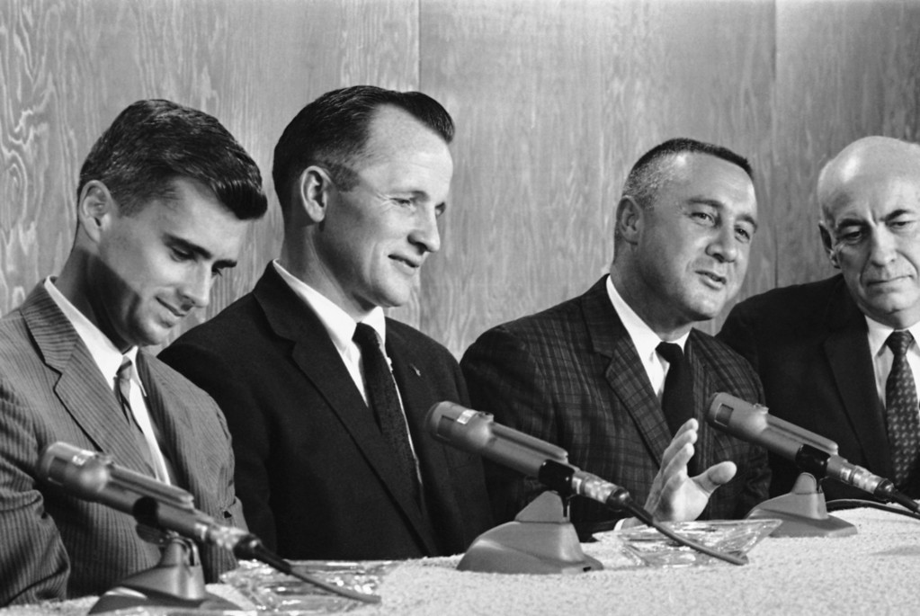 . Lt. Col. Virgil I. Grissom, right, command pilot for the first manned Apollo space flight, explains part of program at a news conference at Manned Spacecraft Center, Houston, Texas on March 22, 1966. The other two crew members named by NASA are Lt. Roger B. Chaffee, USN, left, and Lt. Col. Edward H. White, USAF. (AP Photo)