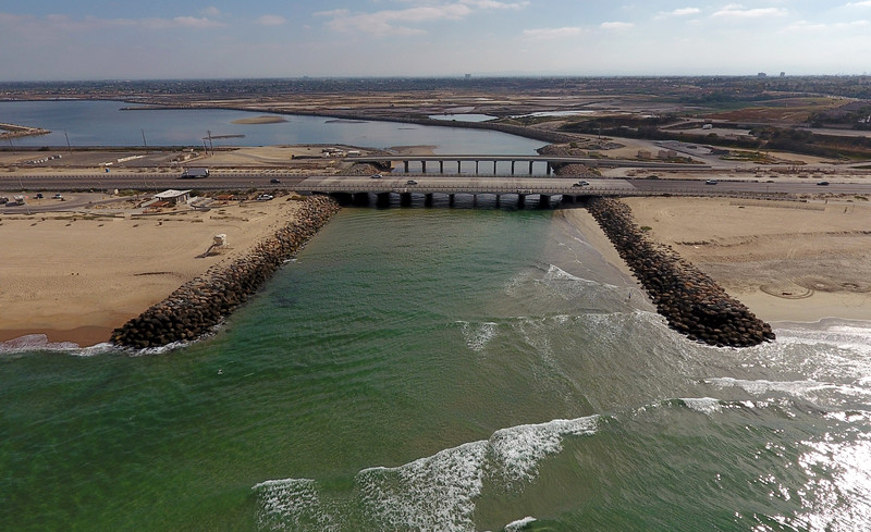 . An inlet from the Pacific Ocean lets water in to the Bolsa Chica Wetlands in Huntington Beach.  (Photo by JEFF GRITCHEN, ORANGE COUNTY REGISTER)