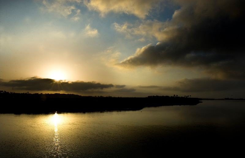 . The sun rises over the Bolsa Chica Ecological Reserve, viewed near the intersection of Warner Avenue and Pacific Coast Highway. ( PHOTO BY,  BRUCE CHAMBERS, ORANGE COUNTY REGISTER)