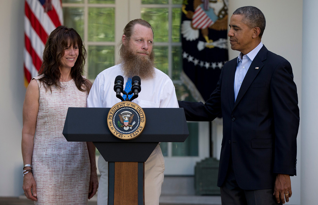 . Accompanied by President Barack Obama, Jani Bergdahl and Bob Bergdahl speak during a news conference in the Rose Garden of the White House in Washington on Saturday, May 31, 2014 about the release of their son, U.S. Army Sgt. Bowe Bergdahl. Bergdahl, 28, had been held prisoner by the Taliban since June 30, 2009. He was handed over to U.S. special forces by the Taliban in exchange for the release of five Afghan detainees held by the United States. (AP Photo/Carolyn Kaster)