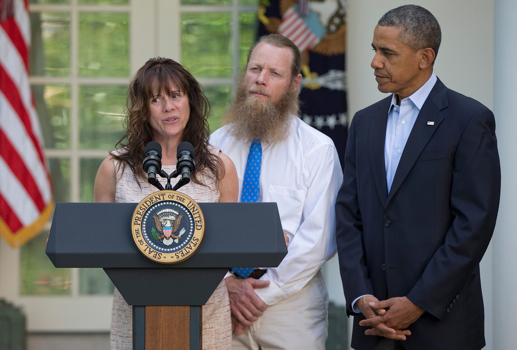 . Accompanied by President Barack Obama, Jani Bergdahl, and Bob Bergdahl speak during a news conference in the Rose Garden of the White House in Washington on Saturday, May 31, 2014 about the release of their son, U.S. Army Sgt. Bowe Bergdahl. Bergdahl, 28, had been held prisoner by the Taliban since June 30, 2009. He was handed over to U.S. special forces by the Taliban in exchange for the release of five Afghan detainees held by the United States. (AP Photo/Carolyn Kaster)