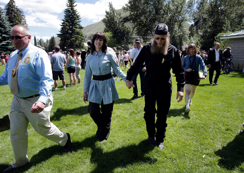 ". Jani Bergdahl, center left, walks with husband, Bob, the parents of captive U.S. Army Sgt. Bowe Bergdahl, at the ""Bring Bowe Back\"" celebration held to honor Sgt. Bergdahl in Hailey, Idaho, Saturday, June 22, 2013. Hundreds of activists for missing service members gathered in a small Idaho town Saturday to hear the parents of the only known U.S. prisoner of war speak just days after his Taliban captors announced they want to exchange him for prisoners being held at Guantanamo Bay. (AP Photo/Jae C. Hong)"