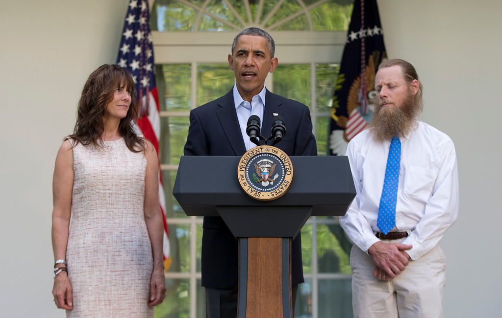 . President Barack Obama speaks with Jani Bergdahl, left, and Bob Bergdahl, right, the parents of U.S. Army Sgt. Bowe Bergdahl, in the Rose Garden of the White House in Washington, Saturday, May 31, 2014, after the announcement that Bowe Bergdahl has been released from captivity. Bergdahl, 28, had been held prisoner by the Taliban since June 30, 2009. He was handed over to U.S. special forces by the Taliban in exchange for the release of five Afghan detainees held by the United States. (AP Photo/Carolyn Kaster)