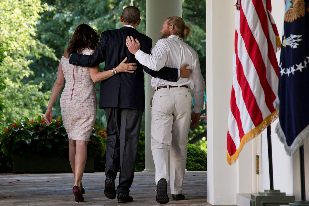 . President Barack Obama walks with Jani Bergdahl, left, and her husband Bob Bergdahl, right after he spoke about the release of their son, U.S. Army Sgt. Bowe Bergdahl, in the Rose Garden of the White House in Washington, Saturday, May 31, 2014. Bergdahl, 28, had been held prisoner by the Taliban since June 30, 2009. He was handed over to U.S. special forces by the Taliban in exchange for the release of five Afghan detainees held by the United States. (AP Photo/Jacquelyn Martin)