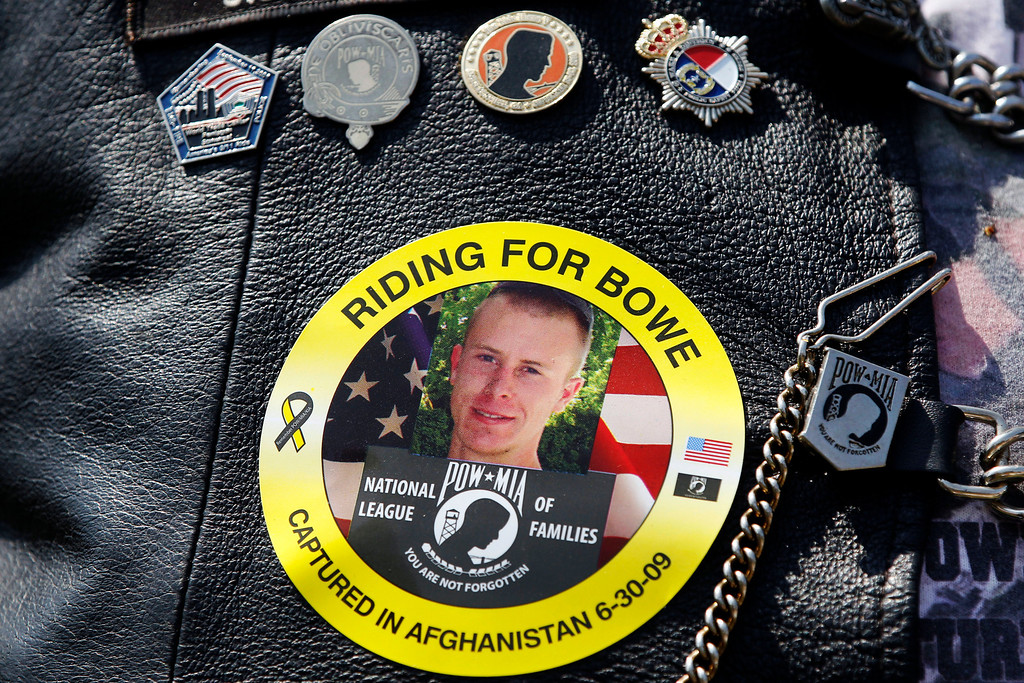 . FILE -- The image of Army Sgt. Bowe Bergdahl of Hailey, Idaho, who is being held captive in Afghanistan, is worn by an audience member as Bergdahl\'s father Bob, not pictured, speaks at the annual Rolling Thunder rally for POW/MIA awareness, in Washington, Sunday, May 27, 2012. A Taliban spokesman, Shaheen Suhail, in an exclusive telephone interview with The Associated Press from the newly opened Taliban offices in Doha, Qatar, said Thursday, that they are ready to hand over U.S. Army Sgt. Bowe Bergdahl held captive since 2009 in exchange for five of their senior operatives being held at the Guantanamo Bay prison. The U.S. is scrambling to save talks with the Taliban after angry complaints from Afghanistan President Hamid Karzai. (AP Photo/Charles Dharapak, File)