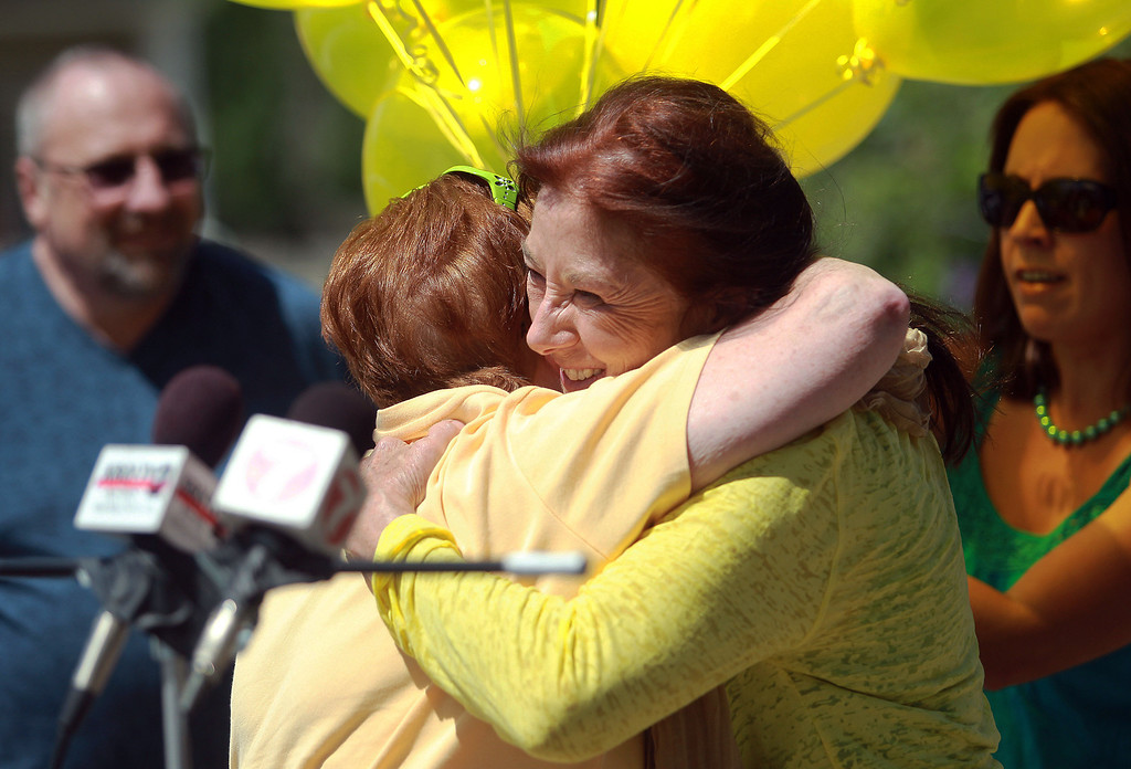 . Sue Martin, center right, owner of Zaney\'s coffee shop, hugs Jane Drussel to celebrate news of Sgt. Bowe Bergdahl\'s release on Saturday, May 31, 2014 in Hailey, Idaho, his hometown. Bergdahl, 28, had been held prisoner by the Taliban since June 30, 2009. He was handed over to U.S. special forces by the Taliban in exchange for the release of five Afghan detainees held by the United States. (AP Photo/The Times-News, Drew Nash)