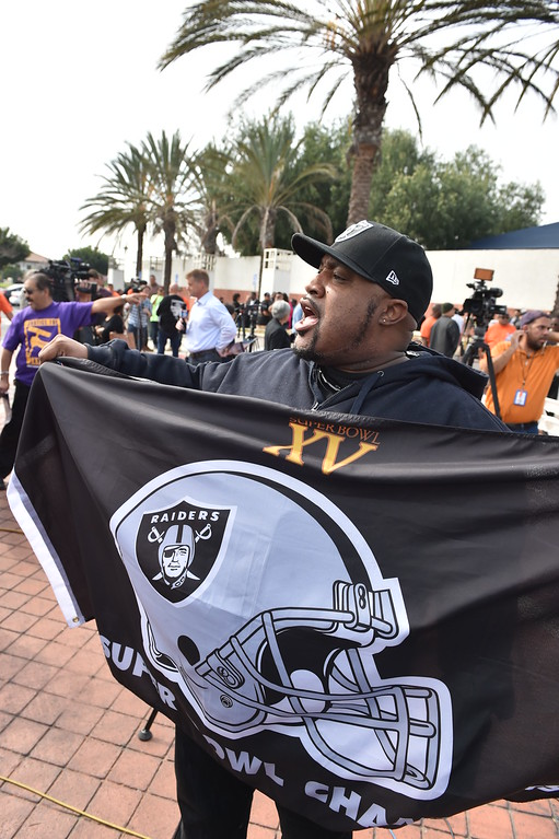 . Tyrone Butterfield cheers on his Raiders. Press conference in Carson to announce stadium proposal to lure 2NFL teams to the city .Photo by Brad Graverson/The Daily Breeze 2-20-15