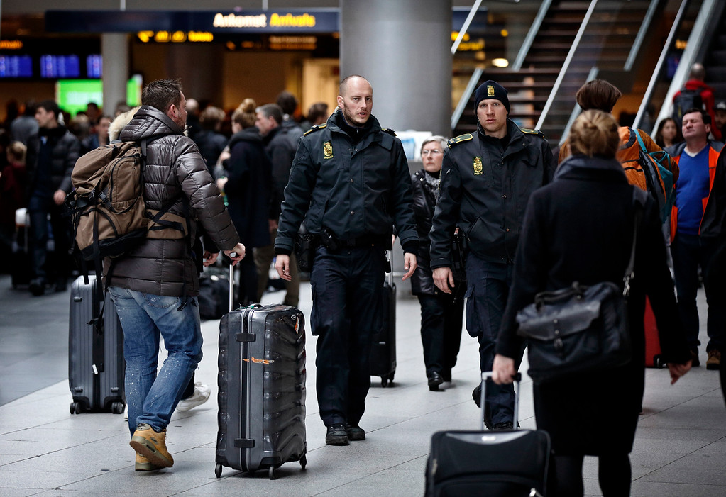 . Danish police patrol Copenhagen International Airport, in Kastrup, Denmark, Tuesday, March 22, 2016. Authorities in Europe have tightened security at airports, on subways, at the borders and on city streets after deadly attacks Tuesday on the Brussels airport and its subway system. (Jens Dresling/POLFOTO via AP)