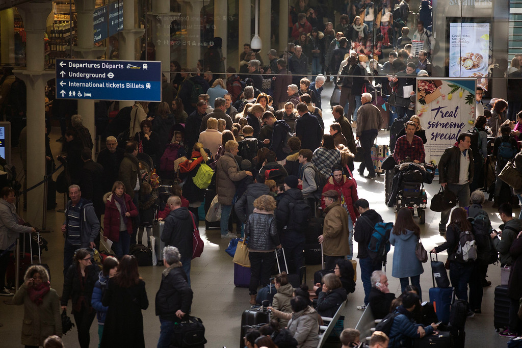 . Travelers stand in a queue after services were suspended on the Brussels Eurostar train route because of the attacks in Belgium, at St Pancras international railway station in London, Tuesday, March 22, 2016. Authorities locked down the Belgian capital on Tuesday after explosions rocked the Brussels airport and subway system, killing a number of people and injuring many more. (AP Photo/Matt Dunham)