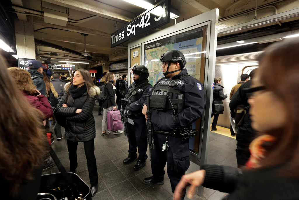 . New York City Police Department Transit officers patrol a Times Square subway platform, in New York, Tuesday, March 22, 2016. Authorities are increasing security throughout New York City following explosions at the airport and subway system in the Belgian capital of Brussels.  (AP Photo/Richard Drew)
