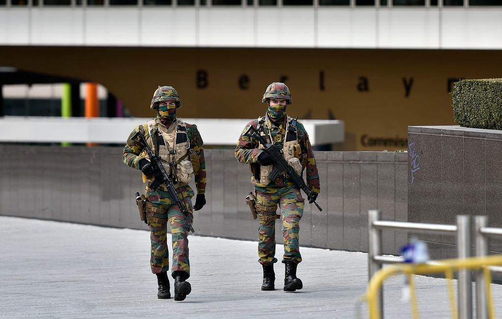 . Special police patrol in front of the EU building in Brussels, Tuesday, March 22, 2016. Explosions, at least one likely caused by a suicide bomber, rocked the Brussels airport and its subway system Tuesday, prompting a lockdown of the Belgian capital and heightened security across Europe. (AP Photo/Martin Meissner)