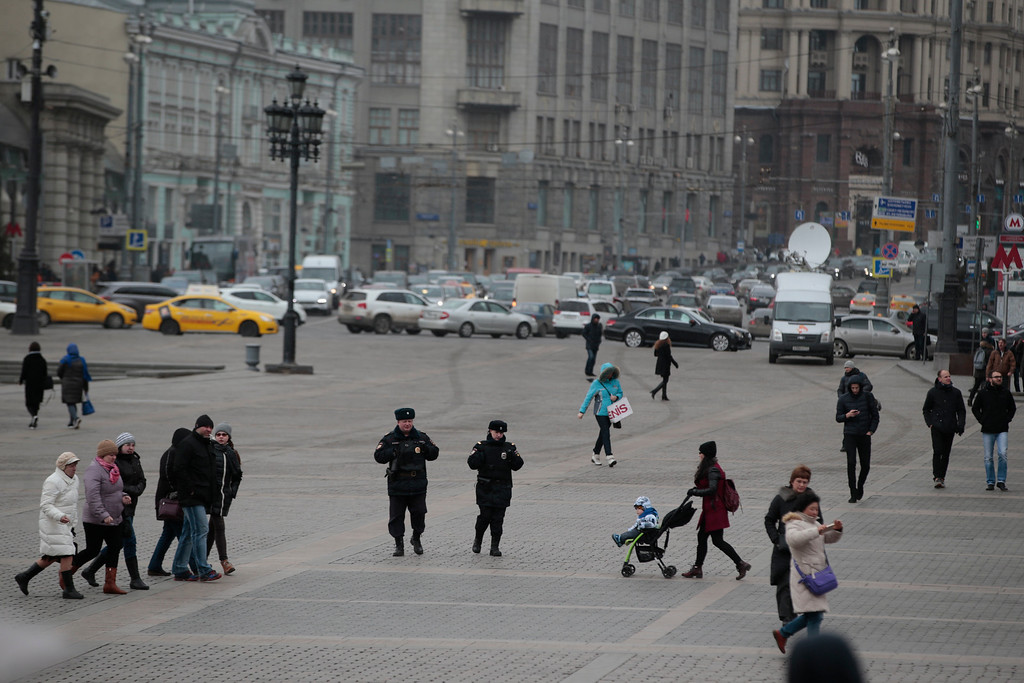 . Police officers patrol in downtown Moscow, Russia, Tuesday, March 22, 2016. Authorities in Europe have tightened security at airports, on subways, at the borders and on city streets after deadly attacks Tuesday on the Brussels airport and its subway system. (AP Photo/ Pavel Golovkin)