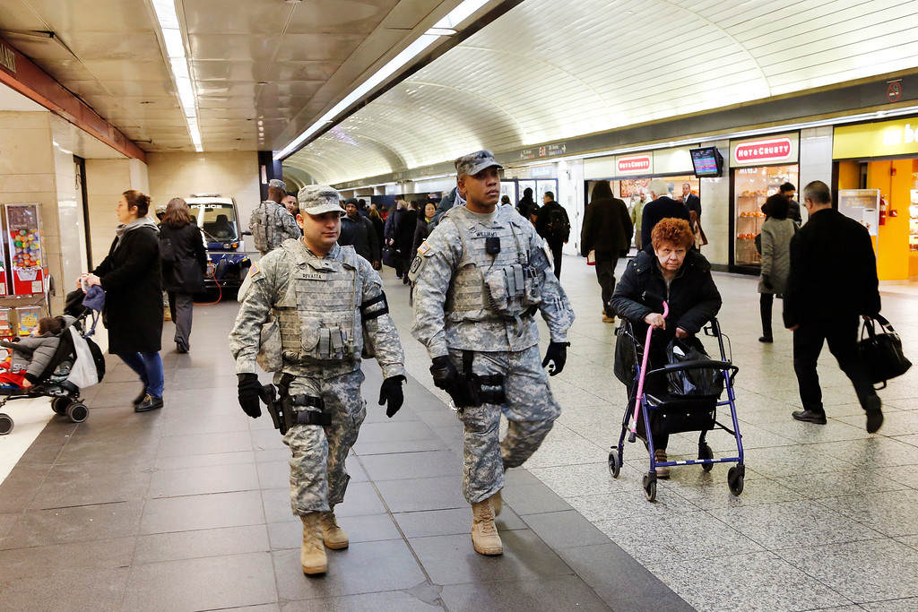 . Members of the New York National Guard patrol Penn Station, Tuesday, March 22, 2016, in New York. Authorities are increasing security throughout New York City following explosions at the airport and subway system in Brussels. (AP Photo/Mark Lennihan)
