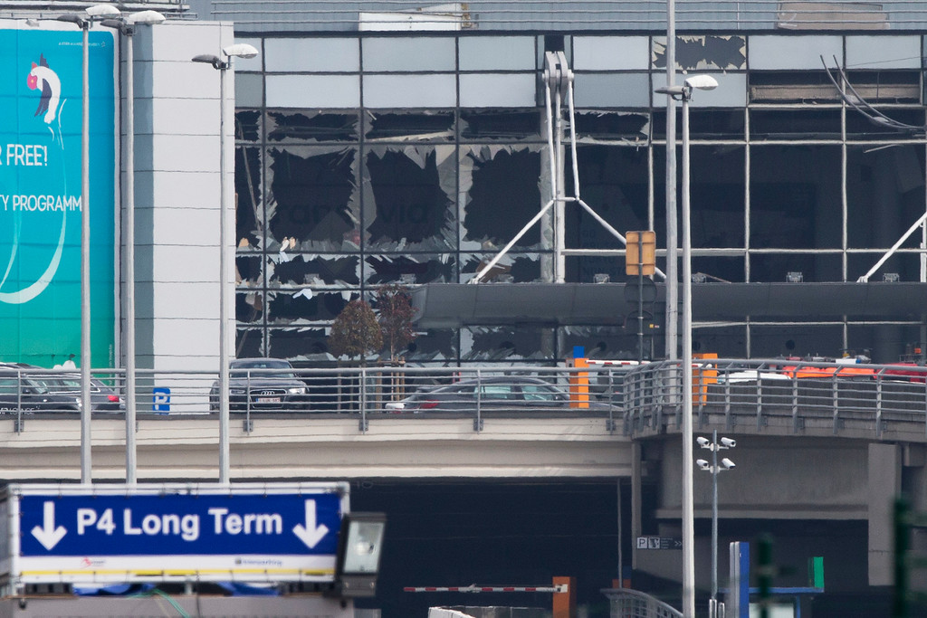 . The blown out windows of Zaventem airport are seen after a deadly attack in Brussels, Belgium, Tuesday, March 22, 2016. Authorities in Europe have tightened security at airports, on subways, at the borders and on city streets after deadly attacks Tuesday on the Brussels airport and its subway system. (AP Photo/Peter Dejong)
