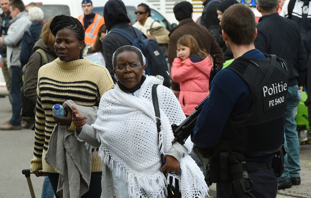 . People are evacuated from Zaventem Airport in Brussels after an explosion on Tuesday, March 22, 2016. Explosions, at least one likely caused by a suicide bomber, rocked the Brussels airport and subway system Tuesday, prompting a lockdown of the Belgian capital and heightened security across Europe. At least 26 people were reported dead. (AP Photo/Geert Vanden Wijngaert)