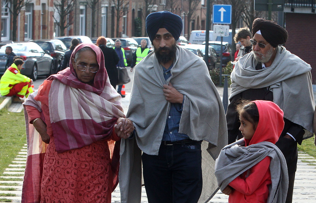 . Passengers leave a gym where they took shelter after the explosions, near  the  Zaventem Airport in Brussels, Tuesday, March 22, 2016. Bombs struck the Brussels airport and one of the city\'s metro stations Tuesday, killing and wounding dozens of people, as a European capital was again locked down amid heightened security threats. (AP Photo/Michel Spingler)