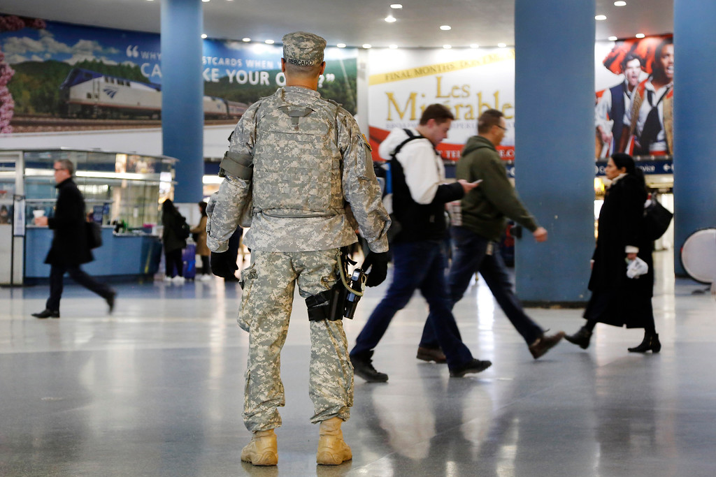. A member of the New York National Guard patrols Penn Station, Tuesday, March 22, 2016, in New York. Authorities are increasing security throughout New York City following explosions at the airport and subway system in Brussels. (AP Photo/Mark Lennihan)