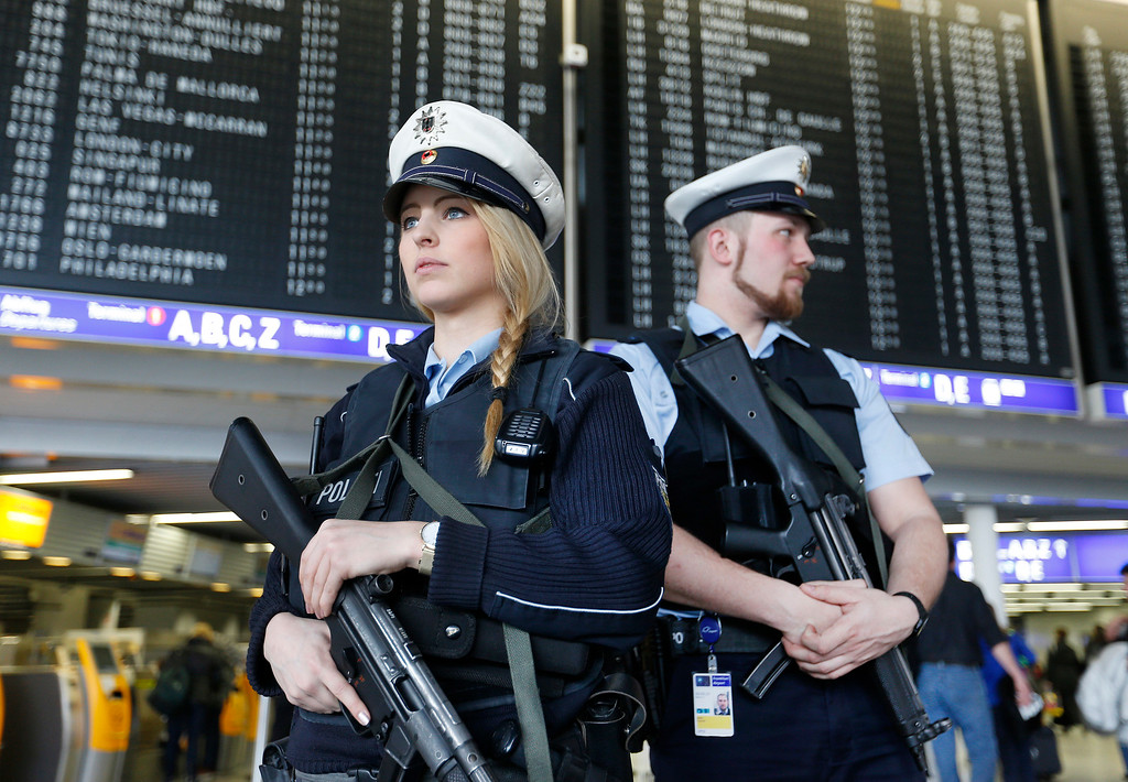 . German police officers guard  a terminal of the airportthe  in Frankfurt, Germany, during tighter security measures  Tuesday, March 22, 2016, when various explosions hit the  Belgian capital  Brussels killing several people. (AP Photo/Michael Probst)
