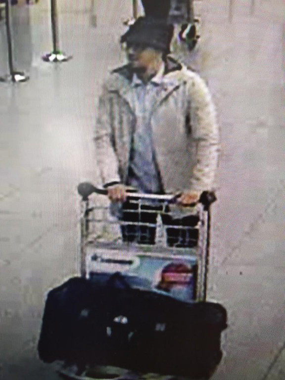 . In this image provided by the Belgian Federal Police in Brussels on Tuesday, March 22, 2016, a man who is suspected of taking part in the attacks at Belgium\'s Zaventem Airport and is being sought by police. Bombs exploded at the Brussels airport and one of the city\'s metro stations Tuesday, killing and wounding scores of people, as a European capital was again locked down amid heightened security threats. (Belgian Federal Police via AP)
