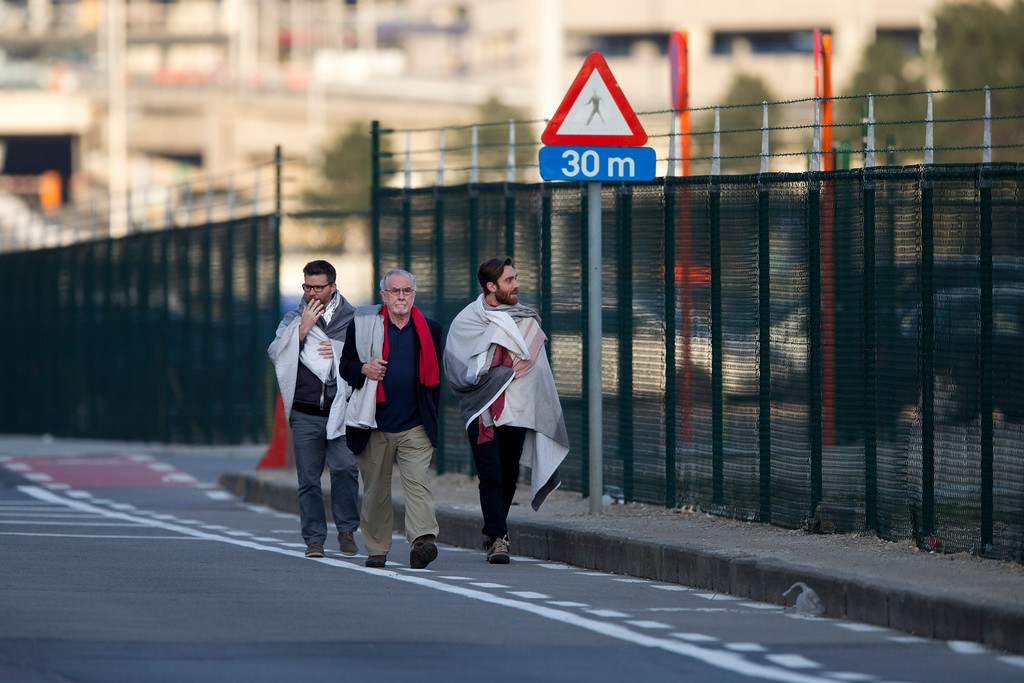 . People leave Zaventem airport, one of the sites of two deadly attacks in Brussels, Belgium, Tuesday, March 22, 2016. Authorities in Europe have tightened security at airports, on subways, at the borders and on city streets after the attacks Tuesday on the Brussels airport and its subway system. (AP Photo/Peter Dejong)